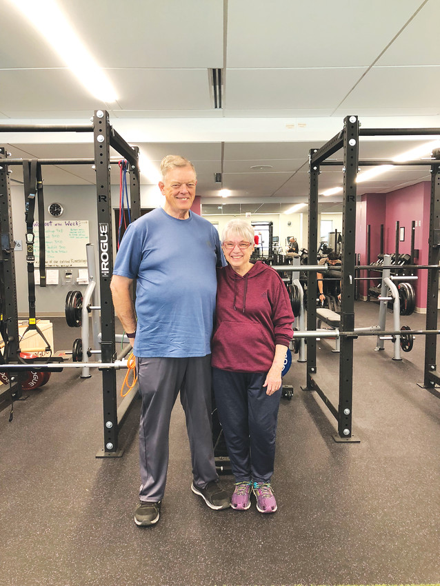 Sally Robertson stands with her husband, Bob, at HealthFit Gym in Castle Rock where she trained before the Wyoming Senior Olympics.