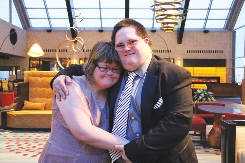 Katherine Moore, 26, left, and Stevie Lawson, 28, stand together at the Night to Shine event at the Hilton Denver Inverness hotel just outside Centennial Feb. 9.  Moore and Lawson have been in a relationship for about 12 years, and they were king and queen at prom at Columbine High School when they were students there.