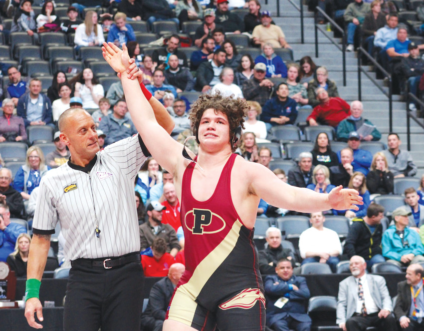 Ponderosa junior Cohlton Schultz is declared the state champion after he pinned Weston Mayer of Poudre in 1:03 of the title match to capture his third straight state title. Schultz won all four of his matches by pins at the State Wrestling Championships, which concluded Feb. 17 at the Pepsi Center in Denver.