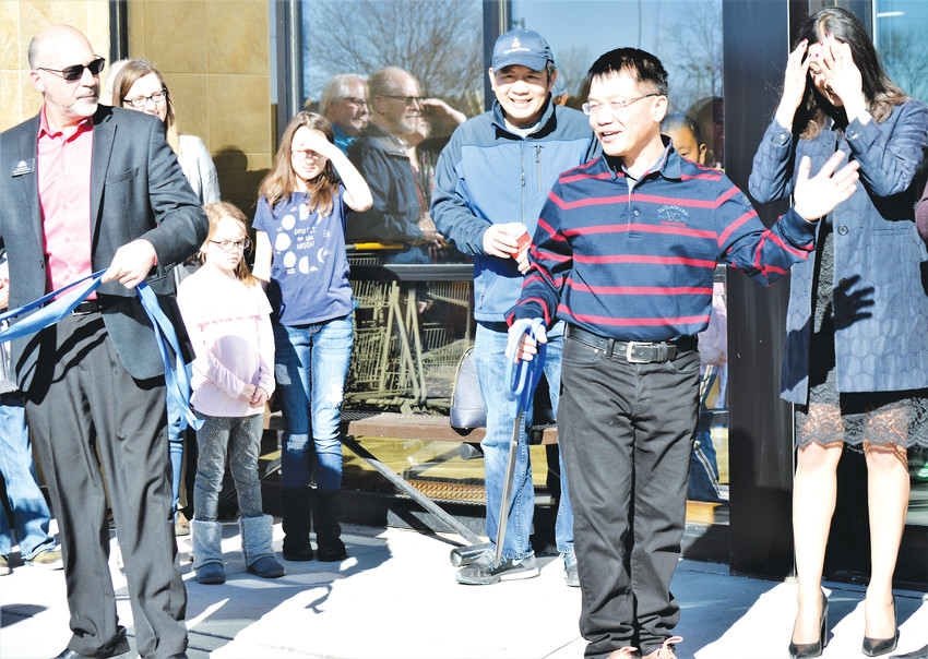 Owner Sherman Wu greets well-wishers at the grand opening of his Local Foods Market on Feb. 18. The Colorado-based grocery store has been more than two years in the making.