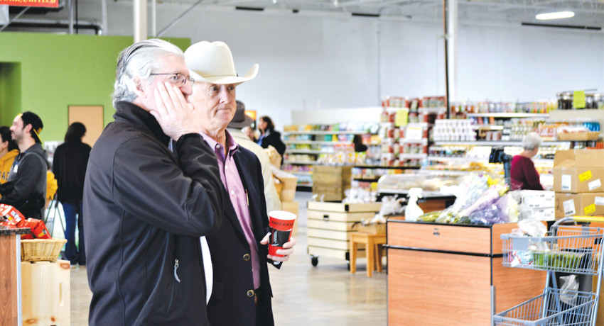 Westmisnter Mayor Herb Atchison and Economic Development Director John Hall take it all in Saturday, Feb. 18, just after cutting the ribbon to open the new Local Foods Market.