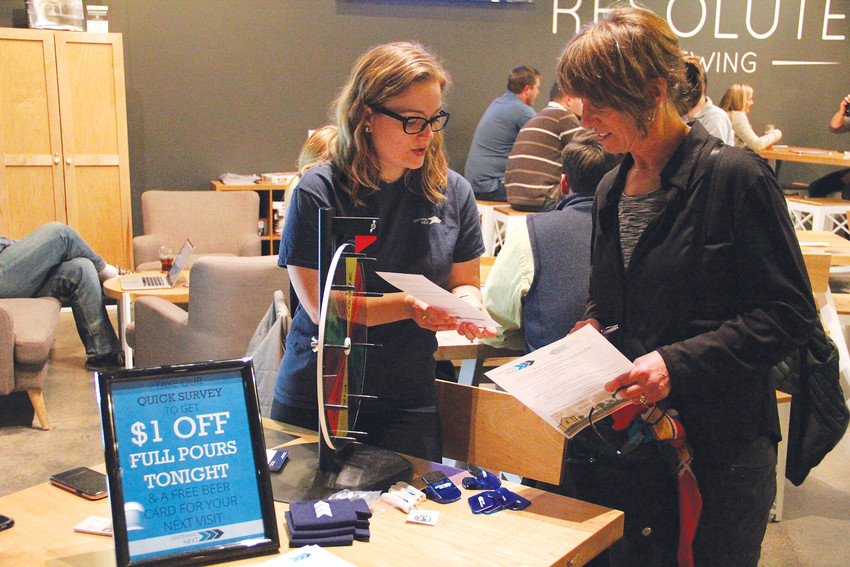 Jenny Houlne, left, a senior planner for the City of Centennial, helps resident Heidi Pearlman-Swartz with a survey about the upcoming Centennial NEXT comprehensive plan for development in the city at a Feb. 13 event at Resolute Brewing Company. The city has conducted outreach for the plan since May 2016.