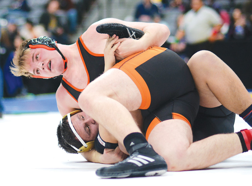 Lakewood senior Hayden Still won six consolation matches over the final two days of the state wrestling tournament at Pepsi Center to take third-place in the Class 5A 285-pound bracket. Still gets back points on Fort Collins senior Jon Engle during the third-place match Feb. 17.