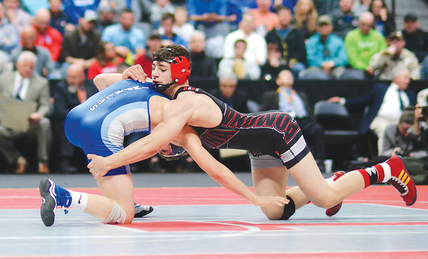 Pomona junior Colton Yapoujian, right, works on Poudre senior Brody Lamb during the Class 5A 138-pound championship match Feb. 17 at Pepsi Center. Yapoujian won his second straight individual wrestling title with a 5-4 victory.