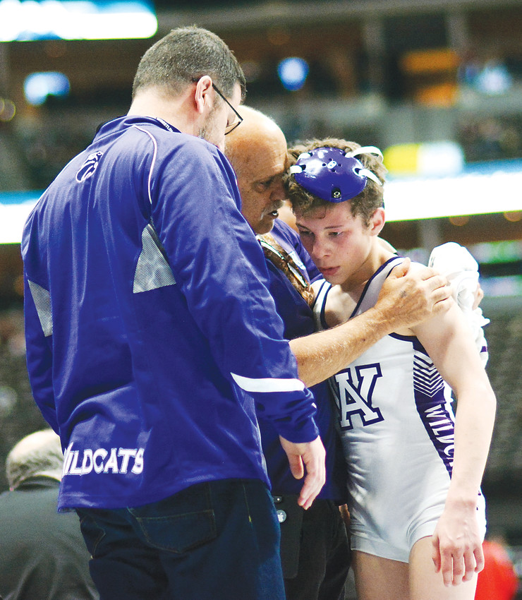 Arvada West sophomore Dylan Kruse, right, is consoled by Wildcats' wrestling coach Ron Granieri after Kruse lost the Class 5A 113-pound fifth-place match, 3-0, against Broomfield junior Presley Madril on Feb. 17 at Pepsi Center.
