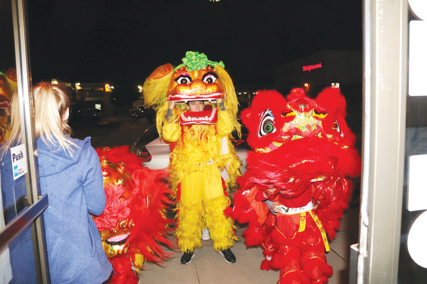 The three lion dance teams from the Denver Shaolin Kung Fu Academy prepare to enter the Twin Dragon Restaurant in Englewood as the main entertainment attraction during the Chinese New Year celebration. There were dancers maneuvering two of the lion dance costumes and one was handled by a single dancer.
