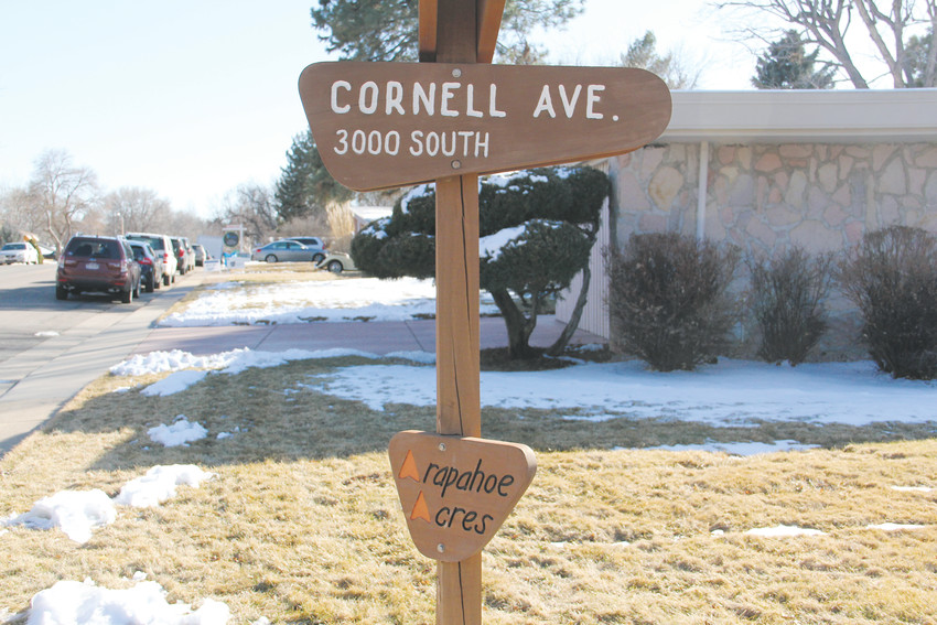 The street sign for East Cornell Avenue in the Arapahoe Acres neighborhood in Englewood during a tour of neighborhood houses Feb. 24. The wooden street signs are a mark of the neighborhood, differing from the street signs seen elsewhere in Englewood.