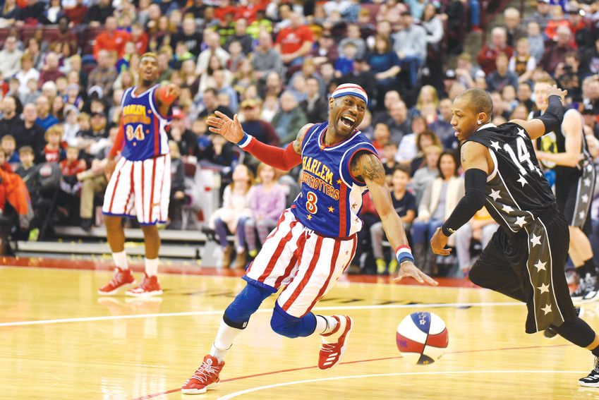 During a 2017 Harlem Globetrotters game, Firefly Fisher shows off his talent and hard-earned skills on the court.