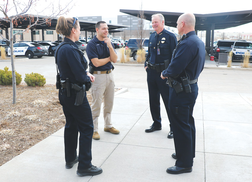 Parker Police Chief David King, second from right, talks with officers outside of the Parker police department, 18600 Lincoln Meadows Pkwy. His team has a large focus on mental health in the community.