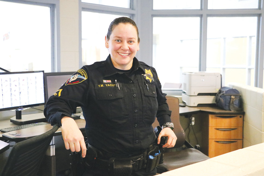 "Douglas County Deputy Tiffany Yacuta stands in the center of the K-Pod, a special management unit in the county's jail that houses inmates with mental health or medical problems. ""I feel like I can advocate for them,"" Yacuta said of inmates experiencing a mental illness."
