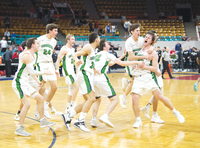 ThunderRidge players jump all over Bailey Verk, far right, who put down the game-winning shot as time ran out March 3 in the 45-43 win over Doherty in Great 8 action.