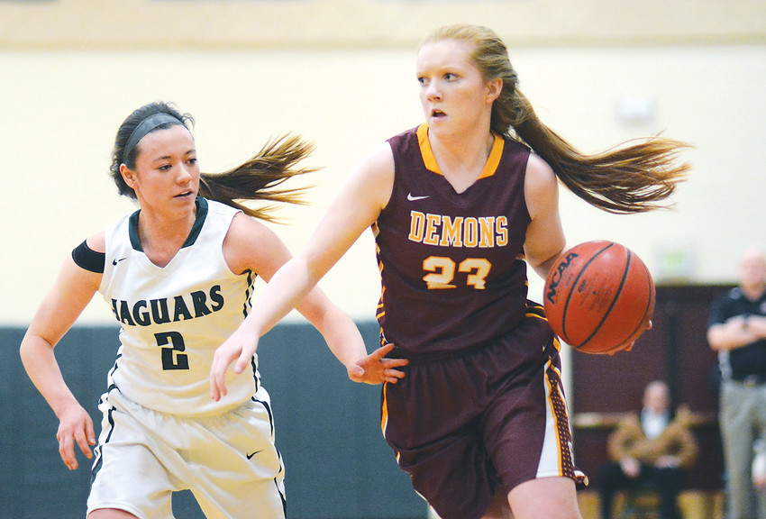 D'Evelyn senior Angi Reed (2) attempts to steal the ball from Golden sophomore Elli Garnett during the Class 4A girls basketball Sweet 16 game Feb. 27 at D'Evelyn Junior/Senior High School.