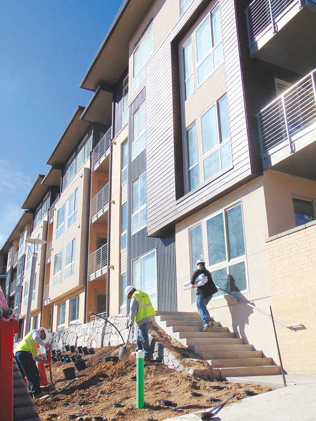 Crews put finishing touches on Vita, an apartment complex nearing completion on Littleton Boulevard. Judges heard oral arguments in a lawsuit appeal regarding the complex's approval on Feb. 27.