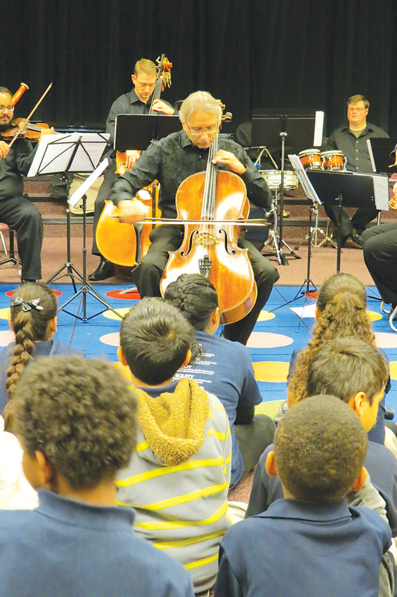 Eric Bertoluzzi plays the cello during a performance of Up Close and Musical for a school class. The Englewood resident is founder of Up Close and Musical and played with the Colorado Symphony for 42 years before retiring but still plays at some Up Close and Musical programs.