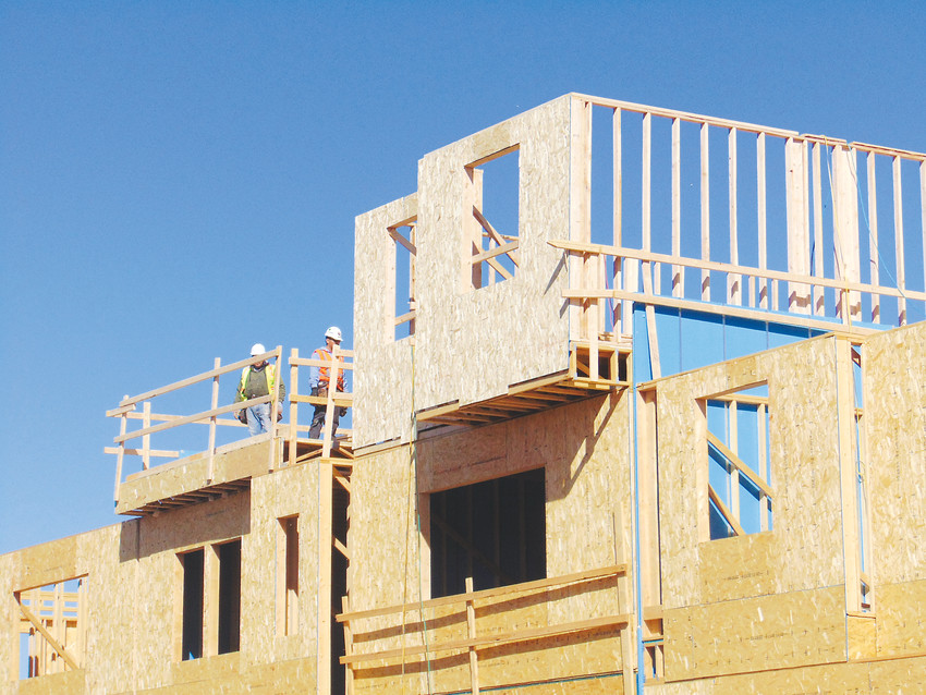 Workers frame townhomes at the Platte 56 development in Littleton on March 1. According to a new report, housing vacancy rates in the Denver metro area will remain critically low for the foreseeable future.