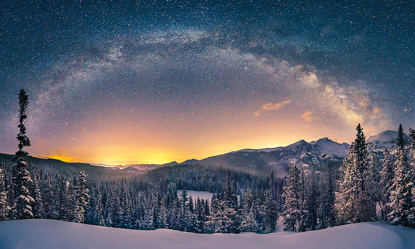 The Milky Way over Longs Peak from the Emerald Lake Trail after an April snowstorm, Rocky Mountain National Park, Colorado.