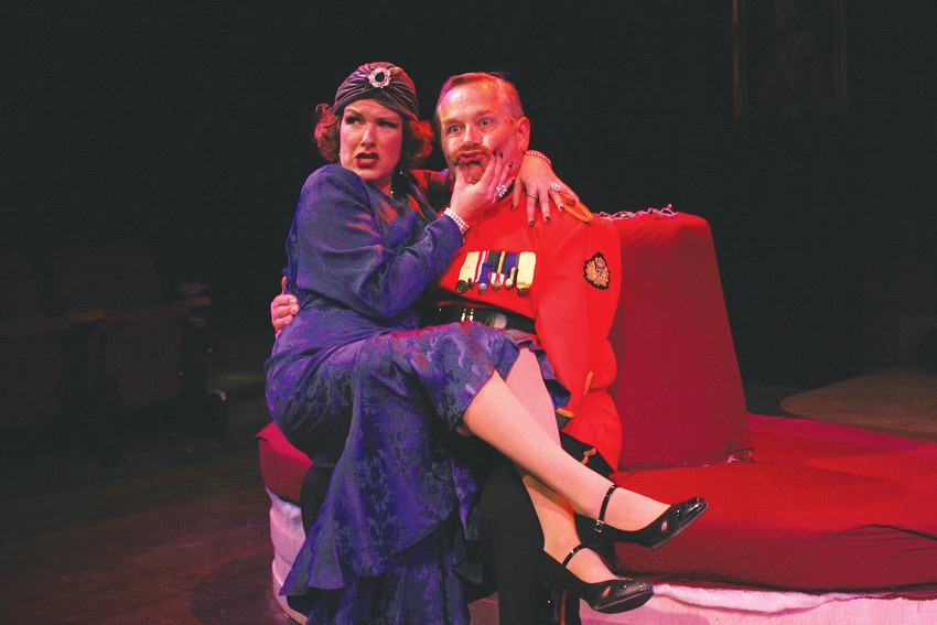 "Eryn Carman (Grace) sings of ""The Man With the Ginger Moustache"" to a baffled Tim Fishbaugh (Col. Gillweather) in a comical scene from ""Something's Afoot"" at Town Hall Arts Center."