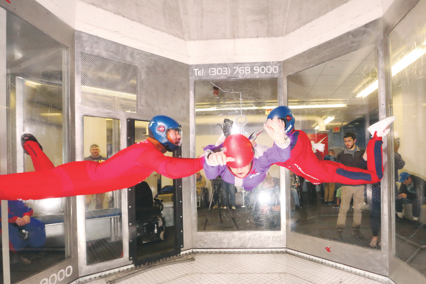 iFly instructors Alex Critchett and Rhanee Schmaltz accompany Trudy Goldman, 73, on her sky dive experience.