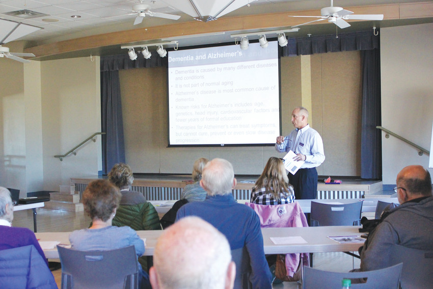 Todd Chambers, licensed clinical social worker, speaks to more than two dozen attendees at the Lone Tree Recreation Center on Feb. 27, about healthy living for your brain and body, including Alzheimer's symptoms and care.