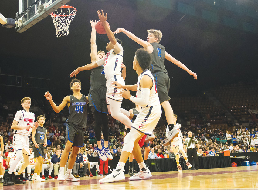 Chaparral's Ronnie DeGray III (23) goes in for the layup in heavy traffic in Great 8 action at the Denver Coliseum Saturday.  DeGray put up 25 points but the Wolverines lost to Grandview, 59-53.