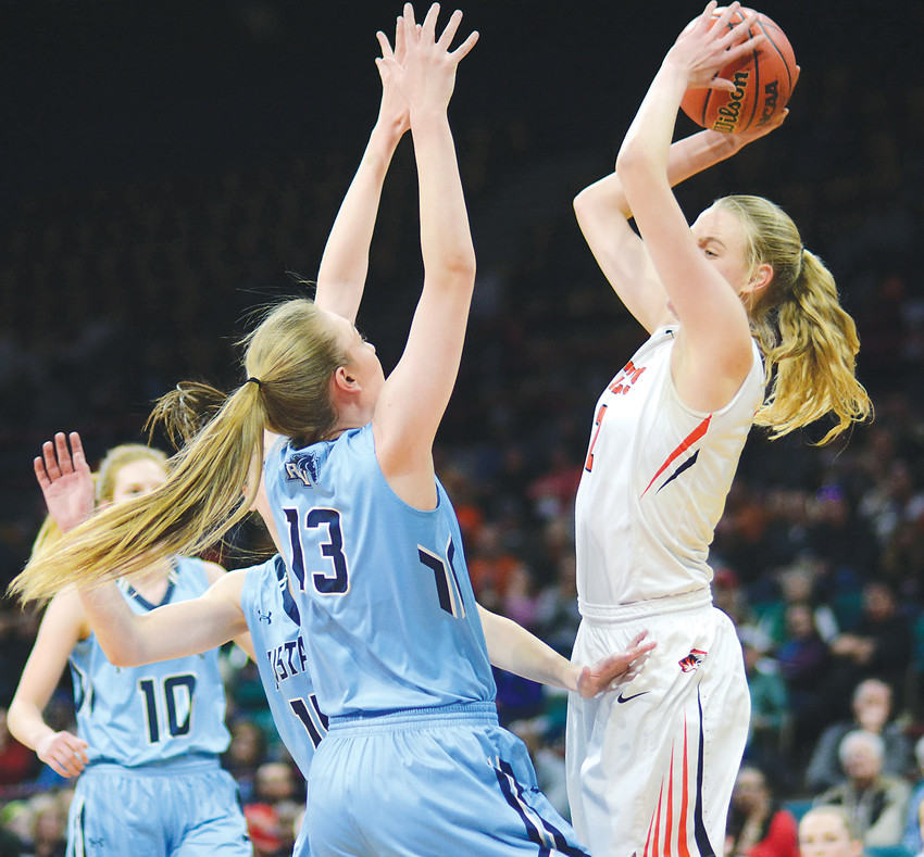 Lakewood senior Camilla Emsbo, right, gets pressure from Ralston Valley senior Delaynie Byrne (13) during the first half on March 2 at the Denver Coliseum. Emsbo had 13 points and 10 rebounds in the Tigers' 61-37 win.