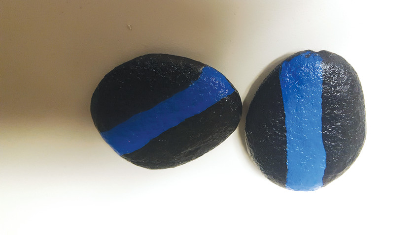 "There will be a handful of ""Thin Blue Line"" rocks hidden throughout Arvada."