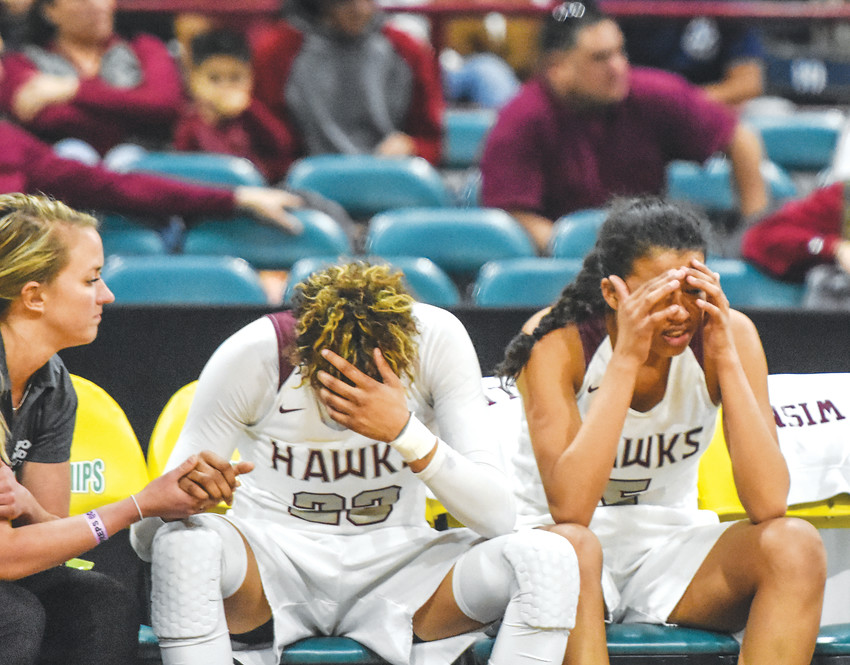Horizon basketball players Izzy Allen, and Caleese Ramirez, right, can't bear to look, as the Hawks lose to Regis Jesuit, 57-43, for a second consecutive year in a CHSAA Girls 5A Great 8 playoff game at the Denver Coliseum on March 2.