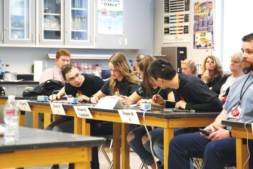 Students from Dakota Ridge consult during a bonus question in the round robin phase of the Science Bowl hosted at their school March 3.