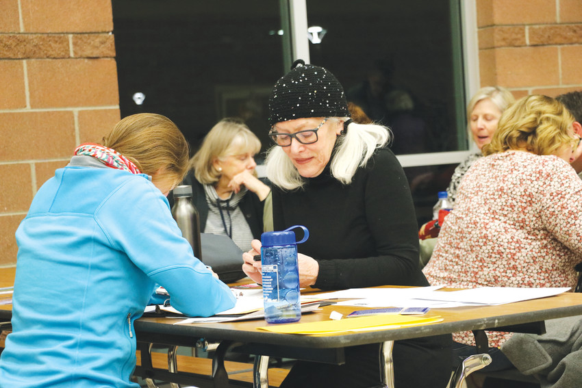Gail Frances, right, discusses candidates and nationwide issues with precinct member Katharine Knarreborg at a Democratic caucus at Rock Canyon High School on March 6. Frances is concerned about public education, infrastructure, women's healthcare and civil rights, she said.