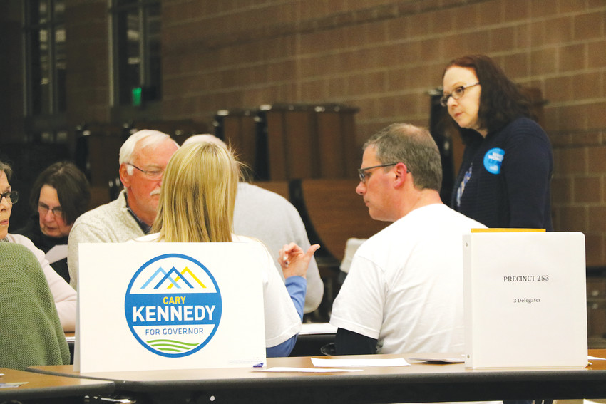 At a Democratic caucus at Rock Canyon High School, members of a precinct discuss which delegates to send to the March 24 party assembly, where candidates on the primary ballot will be determined. About 40 residents attended the March 6 gathering at the high school in Highlands Ranch.