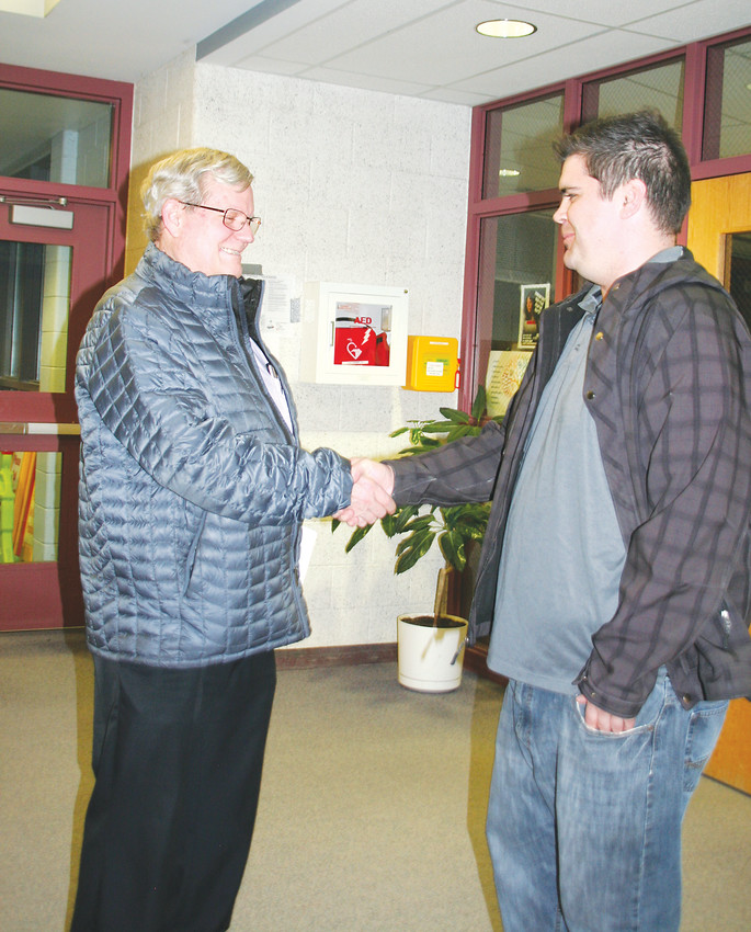 "Neighbors and Jefferson County Republican Party caucus attendees Lee Lusk, left, and Joe Carr shake hands at Bell Middle School in Golden prior to leaving the March 6 caucus. ""We were all in agreeance on the platform proposals we put forward,"" Lusk said. ""It starts here and can go all the way to the national."" Carr added that ""caucus is where the grassroots can be seen, for both parties, because you're working with your neighbors. It brings us together as a community."""