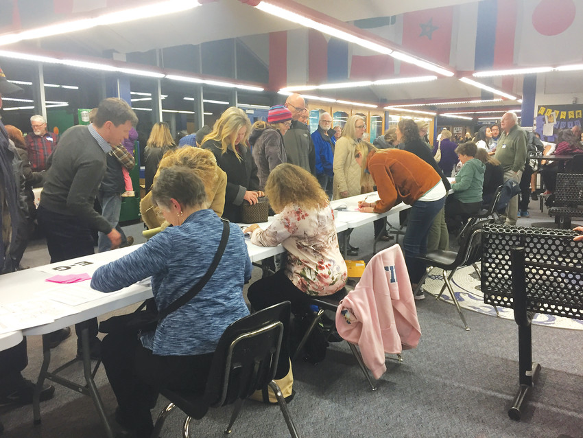 At Alameda High School on March 6, crowds sign in for the Democrats' caucus. The evening was an opportunity to hear from campaigns for several candidates, including Ed Perlmutter, Lesley Dahlkemper and George Stern.
