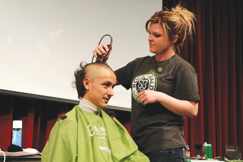 "Megan Boyer used the clippers to remove the remainder of Josh Williams' hair as the Elizabeth High School junior volunteered to have his head shaved to raise money for St. Baldrick Foundation that funds research for cures for childhood cancer. Williams was among the 35 ""Brave the Shave"" volunteers who gave up their hair at the March 1 event at Elizabeth High School. The goal was to raise $10,000 and organizers said they have more than $4,000 in donations and pledges and more are coming in."
