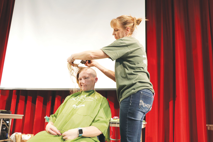 "Sara Mosher grins as Tricia Ackerman removed the remainder of her hair during the March 1 St. Baldrick Foundation ""Brave the Shave"" event at Elizabeth High School. Volunteers stepped up to have their heads shaved and to raise money for the foundation that funds more projects seeking a cure for childhood cancer than any other organization except the federal government."