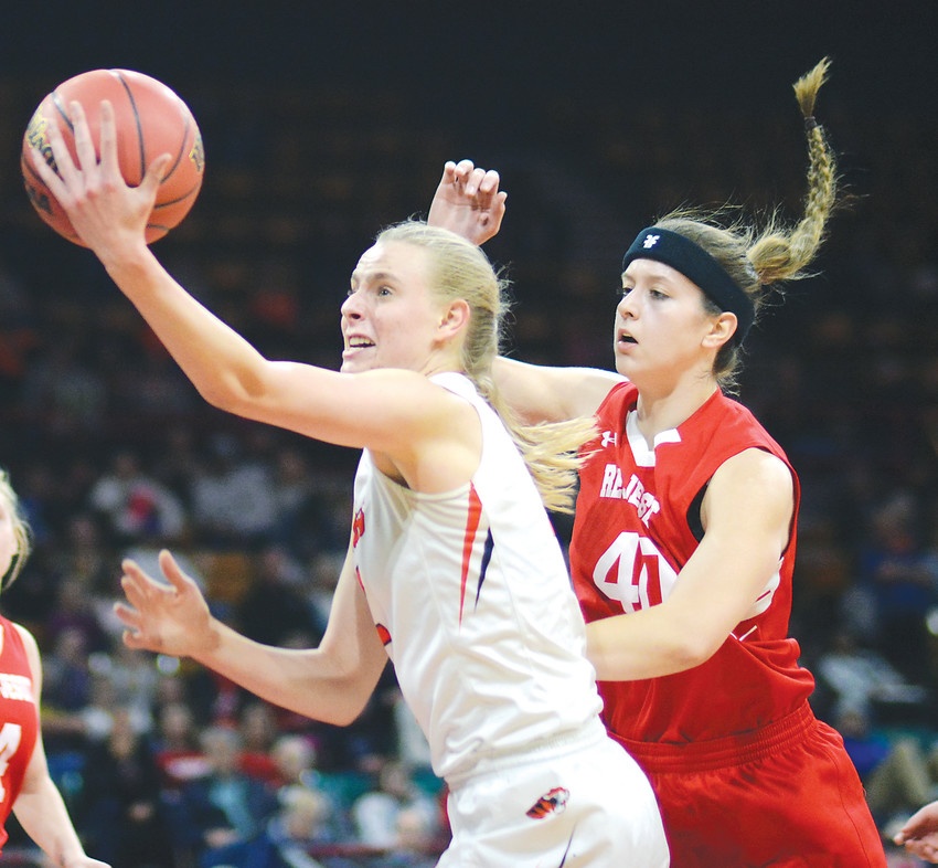 Lakewood senior Camilla Emsbo, left, drives past Regis senior Noelle Cahill during the first half of a Class 5A state semifinal game March 8 at the Denver Coliseum. The Tigers suffered a 47-34 loss to the Raiders to end Lakewood's season.