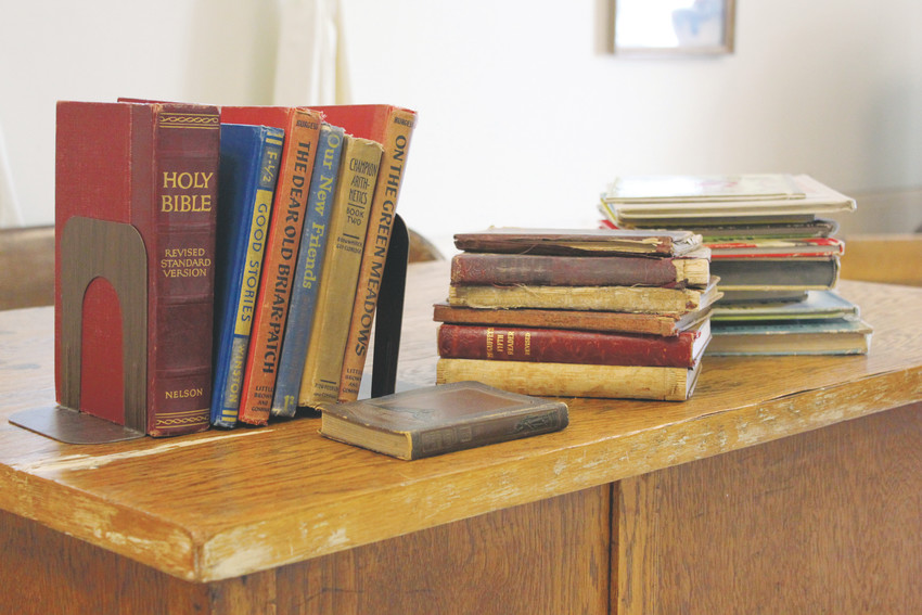The Hilltop Social Club has spent more than 90 years protecting and preserving the Hilltop Schoolhouse and maintaining donations such as these books.