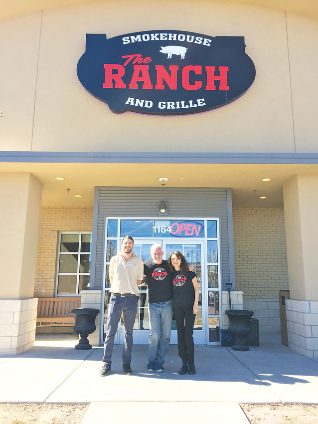 General manager Matt Smith, left, and owners Scott Smith and Joylyn Quintana stand outside of their family-owned restaurant, The Ranch, at 1164 Sergeant Jon Stiles Dr., which opened last December. The owners are getting to know the community and navigating the challenges that come with owning a business.
