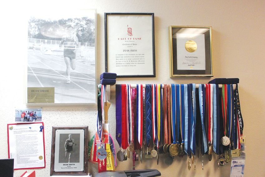 The walls of Lone Tree resident's Dean Smith's home is covered with athletic medals and awards amassed during his lifetime of competing.
