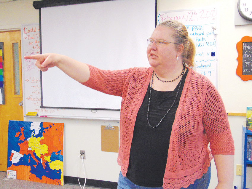 Kiowa school counselor Liz Morrone stands in Randy Wilson's old classroom, and points out how he had the room arranged.