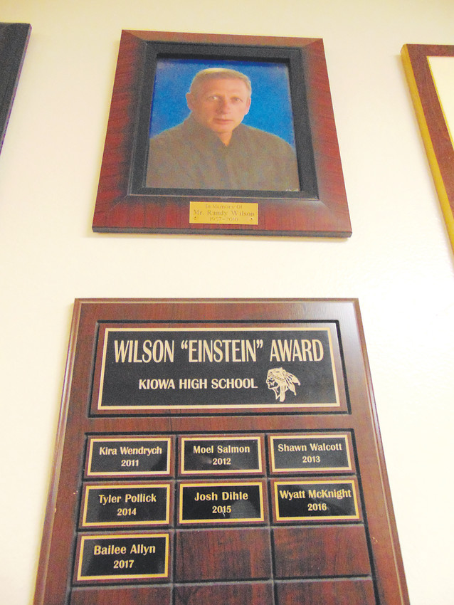 Randy Wilson's final yearbook photo looks down from a hallway in Kiowa's K-12 school, above a list of winners of a scholarship created in his honor.
