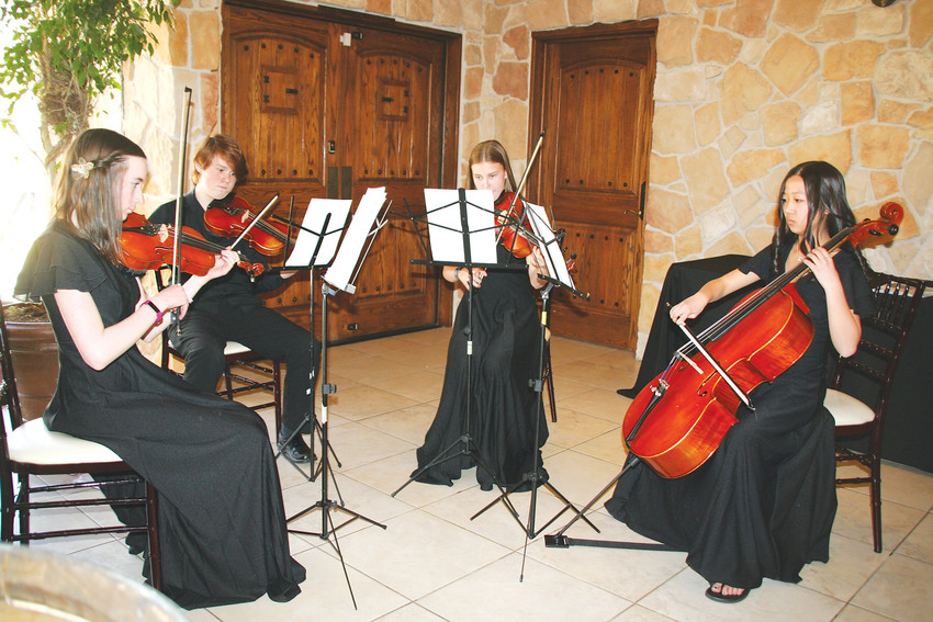 The Golden High School String Quartet performs during the Jeffco International Women's Day event, March 8 at Baldoria on the Water in Lakewood.