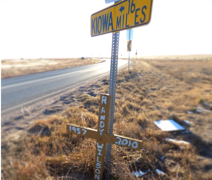 A wooden cross marks the crossroads where Wilson's body was found in June 2010. Photo by David Gilbert