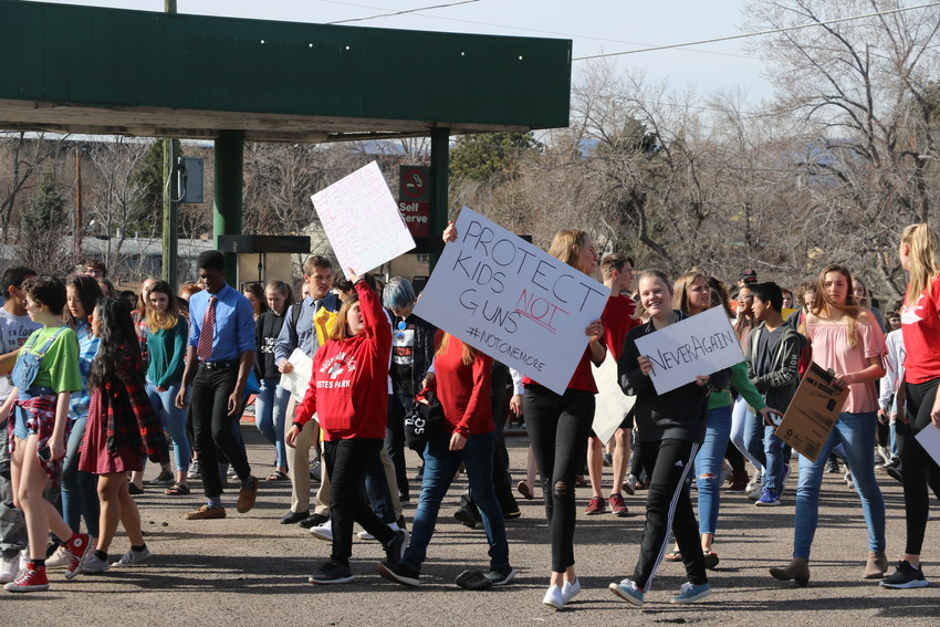 Students walked-out of Lakewood High School carrying a variety of signs urging action on gun violence on March 14, a month after the attack at Parkland, Florida.