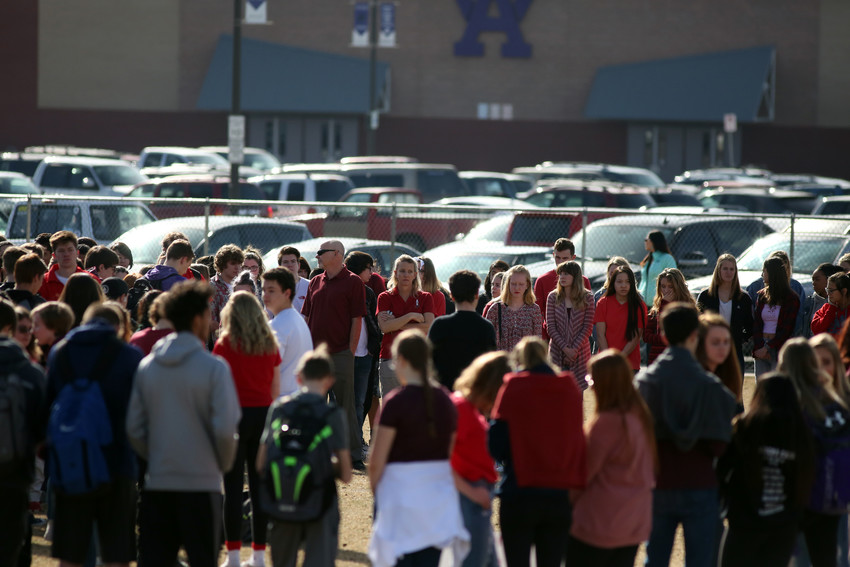 Student and teachers at Arvada West High School stood in silence on the athletic field of their school for 17 minutes to remember the students who died in Florida last month.