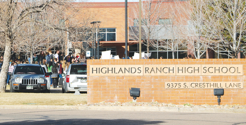 Student protesters carrying white posters gathered in front of Highlands Ranch High School for a national walkout on March 14. They were protesting for the victims of the Feb. 14 school shooting in Florida and for Congress to take action on gun violence.