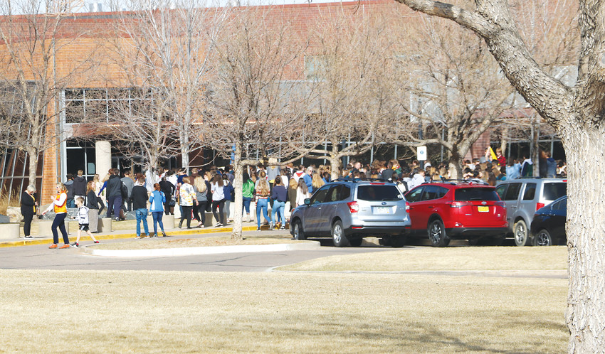About 100 Highlands Ranch High School students gather in front of the school's entrance at the March 14 walkout. Students left class for 17 minutes in honor of the 17 victims of the Feb. 14 school shooting in Florida.