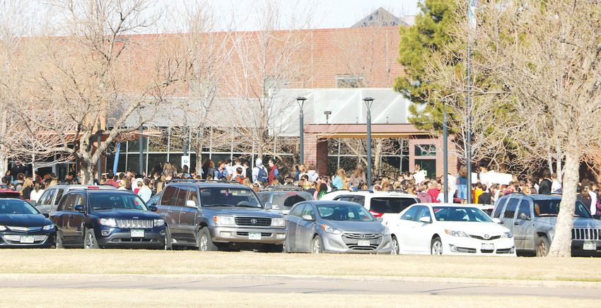 Students fill the front entrance of Highlands Ranch High School for a national walkout on March 14, exactly one month after the school shooting in Florida that killed 17 poeple. Falcons for Progress, a self-described liberal group of students, organized the event.