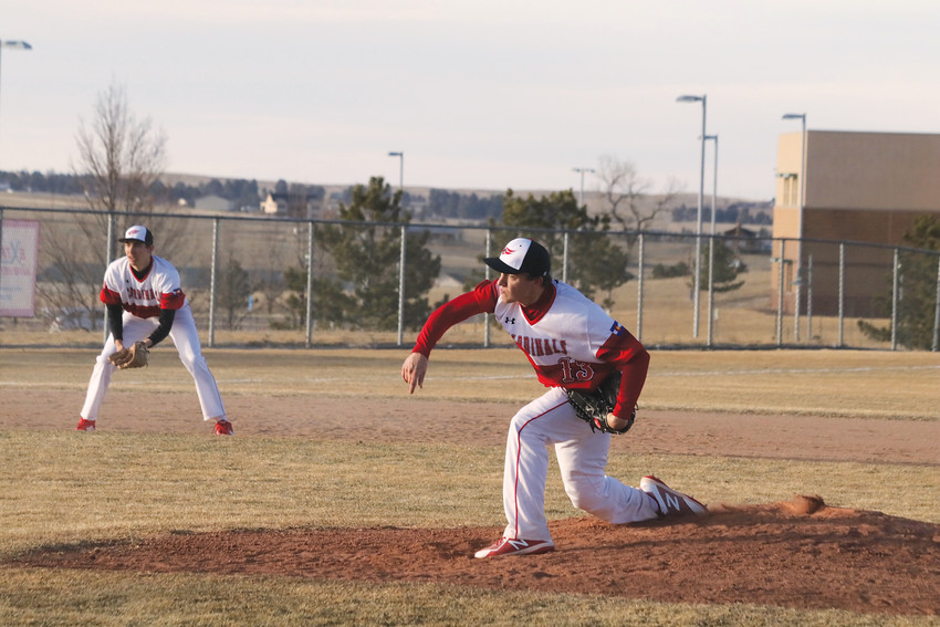 Cardinal pitcher Chase Bauer, 13, delivers a pitch during Elizabeth's March 8 baseball season opener against Cheyenne Mountain. Bauer went the distance on the mound and had a hit to drive in a run as Elizabeth won the game, 5-3.