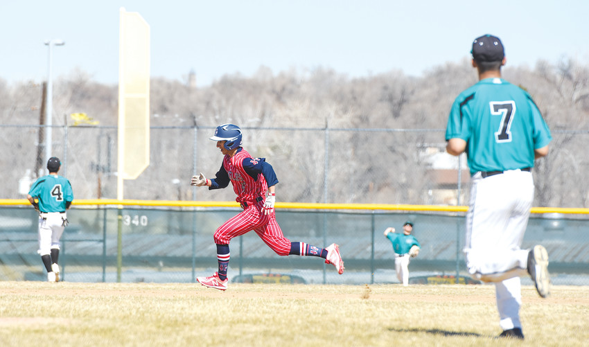 Heritage baserunner Derek Davis advances to third on a base hit to left field, as Westminster infielders Jayden Wright(4), and Edgar Sigala (7), await the throw. It was that kind of day last Saturday March 17, as Heritage scored early and often enroute to a 32-0 rout of the Wolves in Westminster.