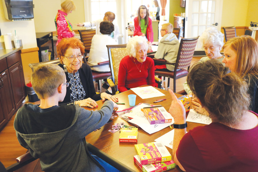 Youth and seniors in Brookdale Highlands Ranch, an assisted living home that provides memory care, come together for crafts on March 15, thanks to Bessie's Hope, a program that coordinates visits between volunteers of all ages and seniors.